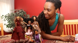 "Queen Cee Robinson and 3 of her homemade ""Barbies"" (Taken from the CBC Article)"